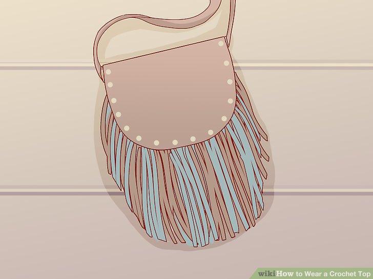 Fügen Sie eine Tasche oder Tasche hinzu, um Ihr Häkeloberteil zu ergänzen.