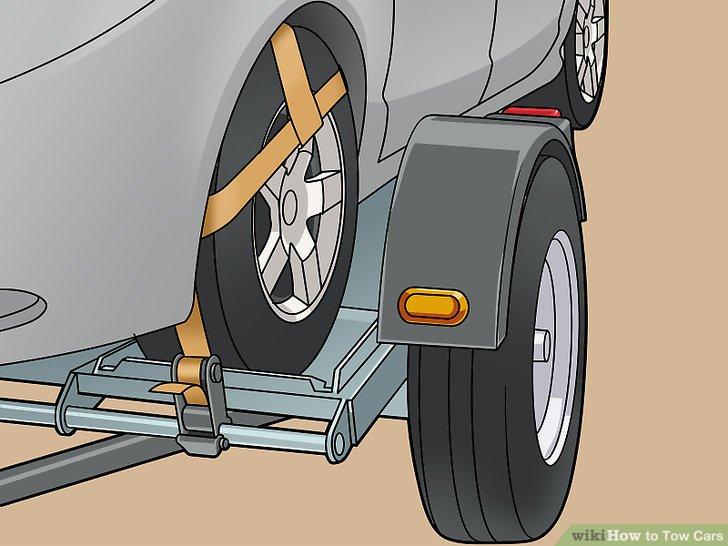 Befestigen Sie das Fahrzeug mit den Radgurten am Dolly.