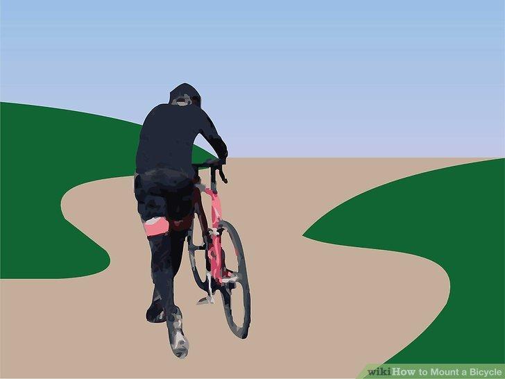 Laufen Sie am Fahrrad entlang und schieben Sie es am Lenker, bis Sie auf Touren kommen.