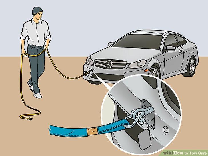 Führen Sie den Gurt oder Haken durch den Wiederherstellungspunkt des defekten Fahrzeugs.