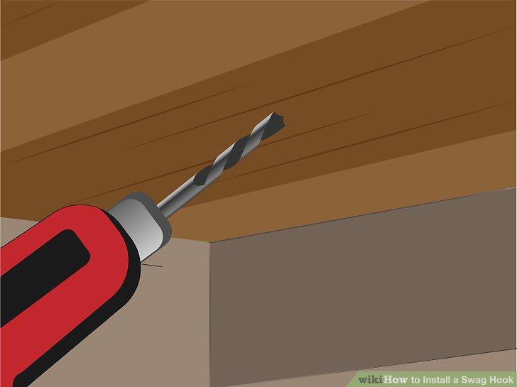 """Bohren Sie in der Mitte der Umreifung mit dem Stollensucher bis zu einer Tiefe, die etwas länger ist als der spitze Gewindeteil des Einsatzes (ca. 2 """")."""