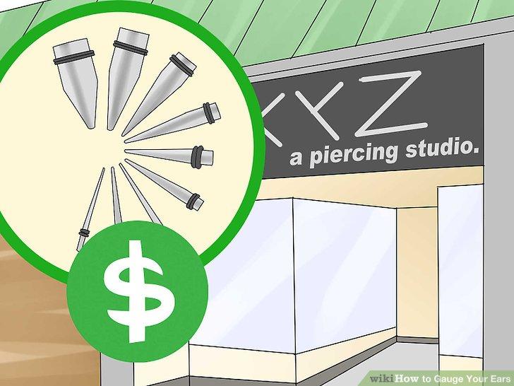 Kaufen Sie in einem Piercingstudio eine Reihe von Ohrenkegeln.