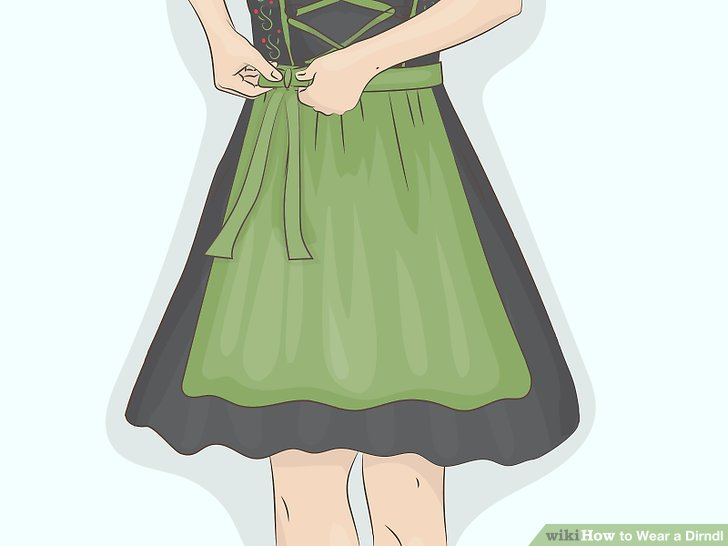 Wrap the apron ties around your back and make a bow in front.