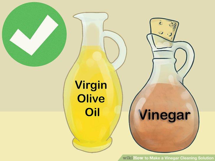 Entfernen Sie Flecken aus Edelstahl mit Essig und Olivenöl.