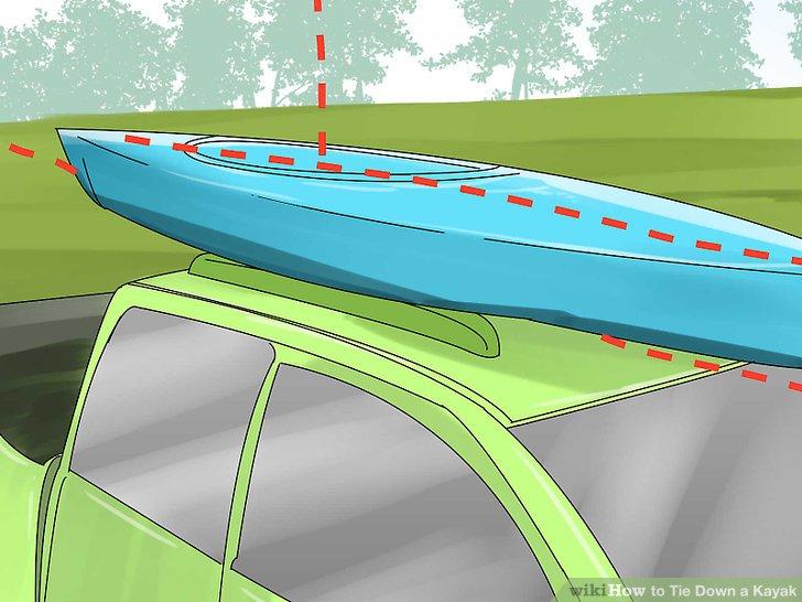 Zentrieren Sie Ihren Kajak auf dem Dachgepäckträger.