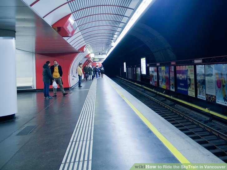 Walk up to the platform area and wait for the train.