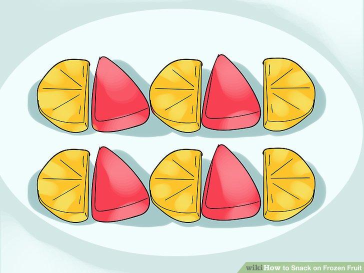 Snack auf gefrorenen Orangen und Wassermelonen.