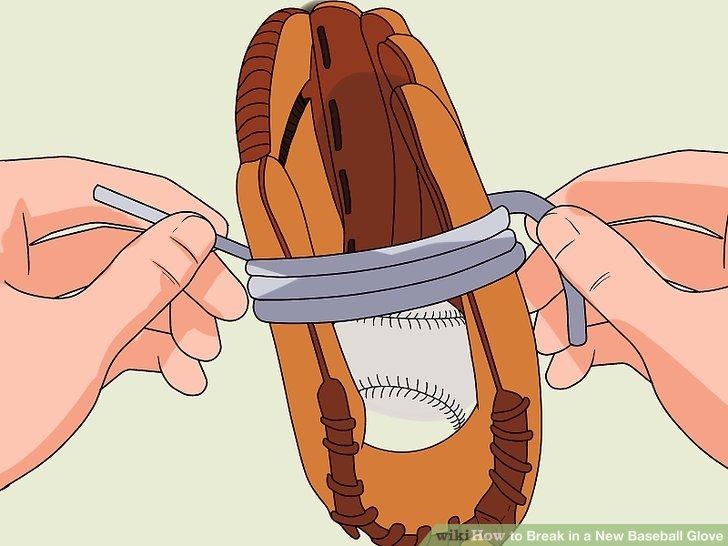 Wickeln Sie mehrere große Gummibänder mit dem Ball im Inneren des Handschuhs.