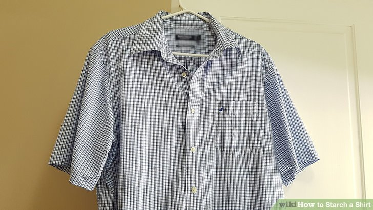 Spray the starch on the front of the shirt.
