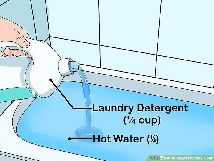 Fill ⅓ of the tub with hot water and add a ¼ cup of laundry detergent.