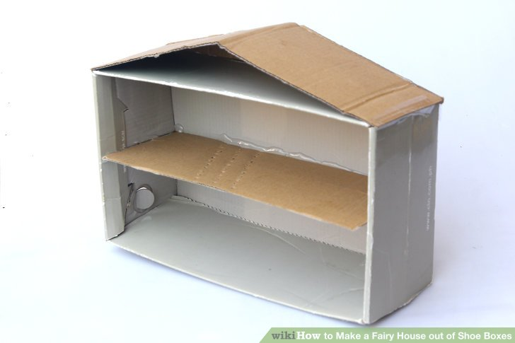 Tape or glue the dividing floor into the middle of the shoe box.