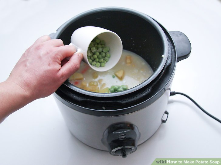 1 Tasse aufgetaute gefrorene Erbsen unterrühren.