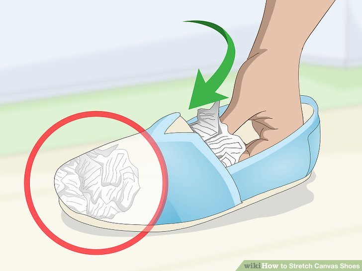 Stuff newspapers into the toes of your shoes to widen them.