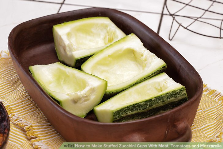 Arrange each zucchini cup on the baking sheet.