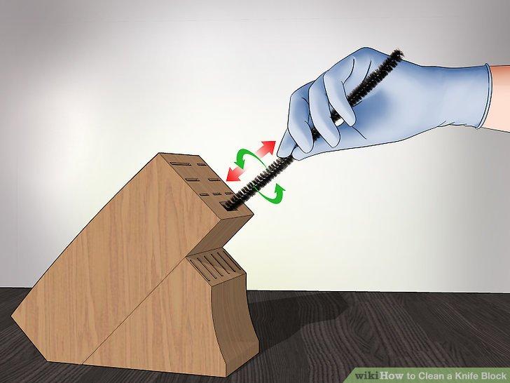 Verwenden Sie einen Pfeifenreiniger, um in die Schlitze zu gelangen.