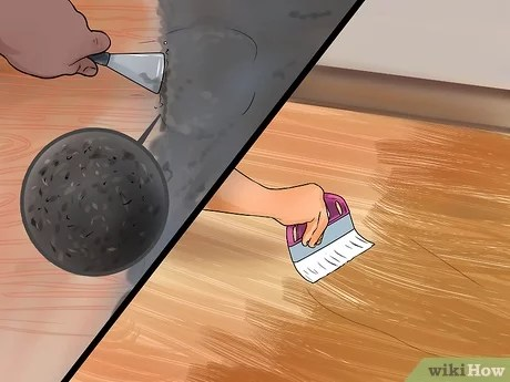 remove adhesive on hardwood floor