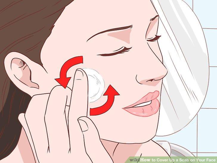 Tupfen Sie eine kleine Menge Feuchtigkeitscreme auf den Schorf.