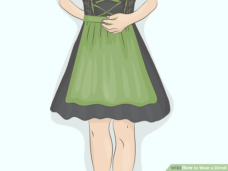Place the apron at your natural waist and button it to the skirt.