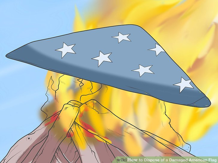 Legen Sie die gefaltete Flagge vorsichtig auf das Feuer.