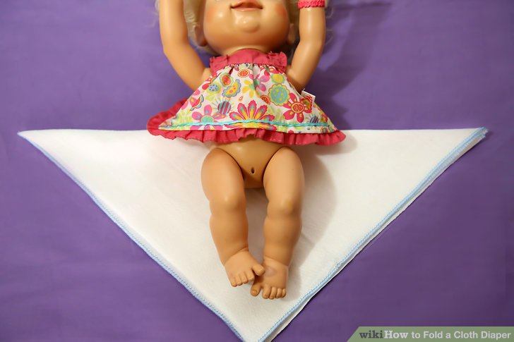 Place the baby on the diaper.