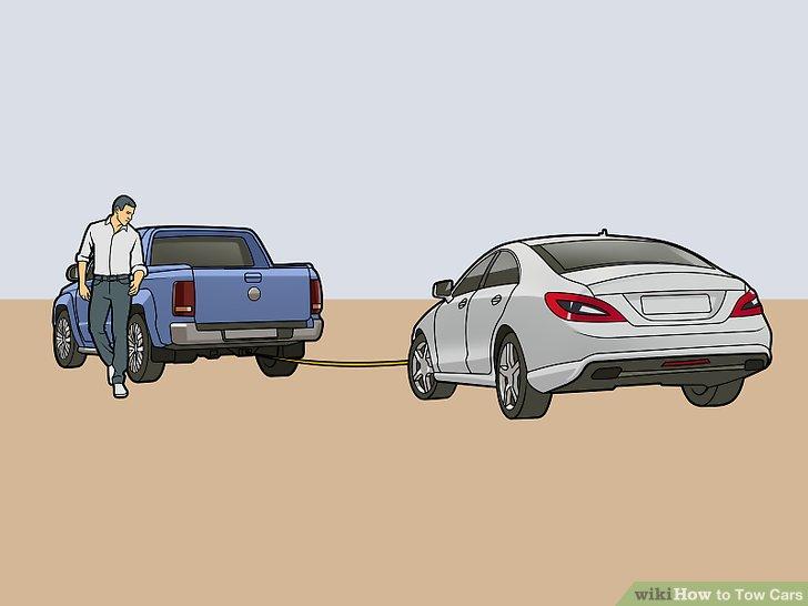 Ziehen Sie das Abschleppfahrzeug langsam nach vorne, bis der Gurt fest ist.