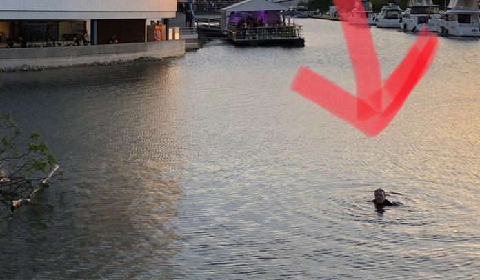 Fã bêbado é expulso de show e tenta voltar nadando