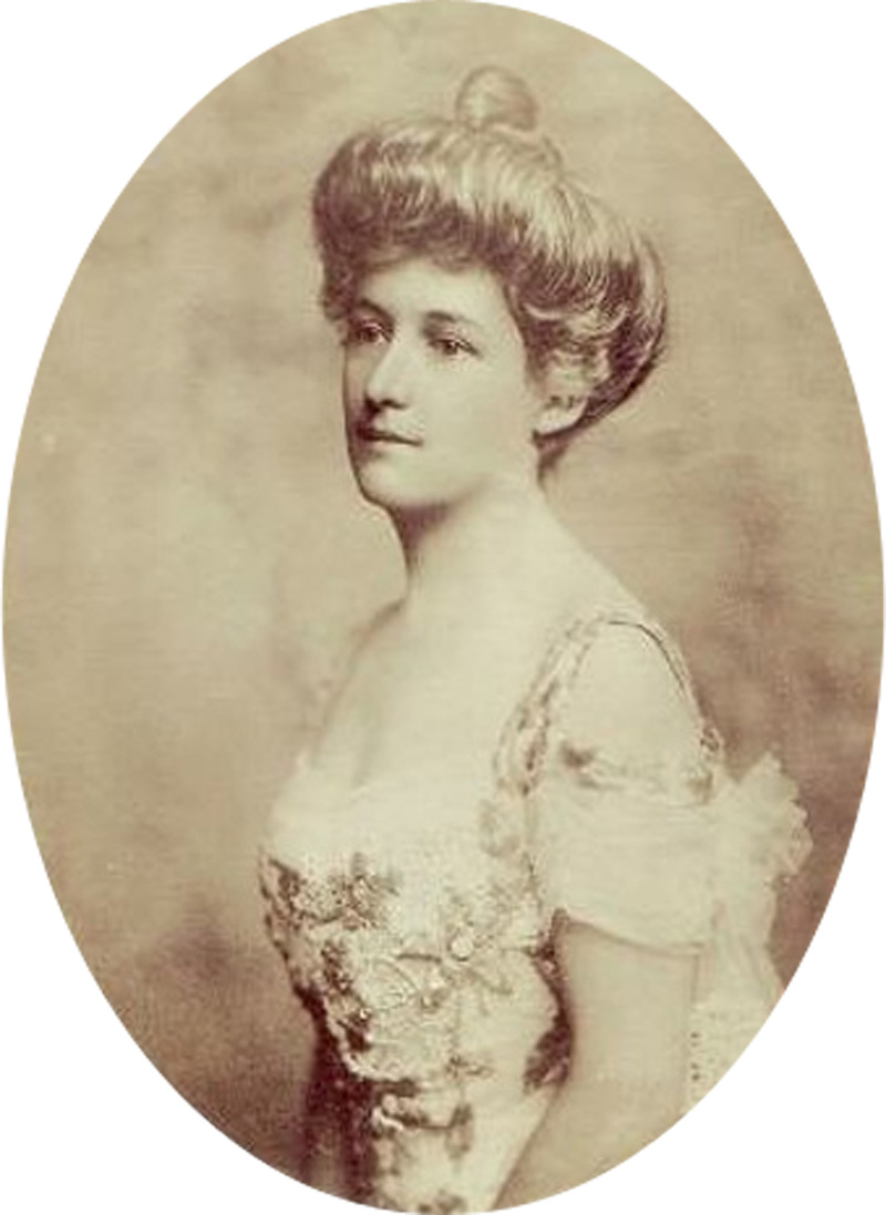 Lucile Polk Carter in a sepia photo wearing a pretty dress and her hair in a bun.