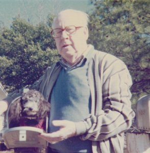 Gramps stands to the right of the open mailbox which contains a tiny dog, wearing a little sweater, Nerd. (1977)