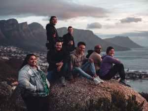 group of tourists on rocky coast