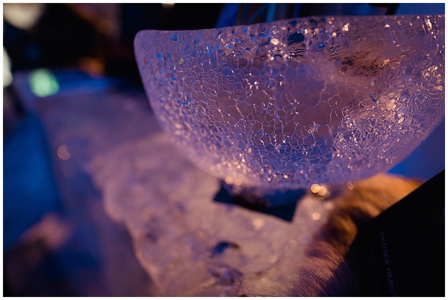 Close up of a bowl made of ice on the ice bar in the igloo