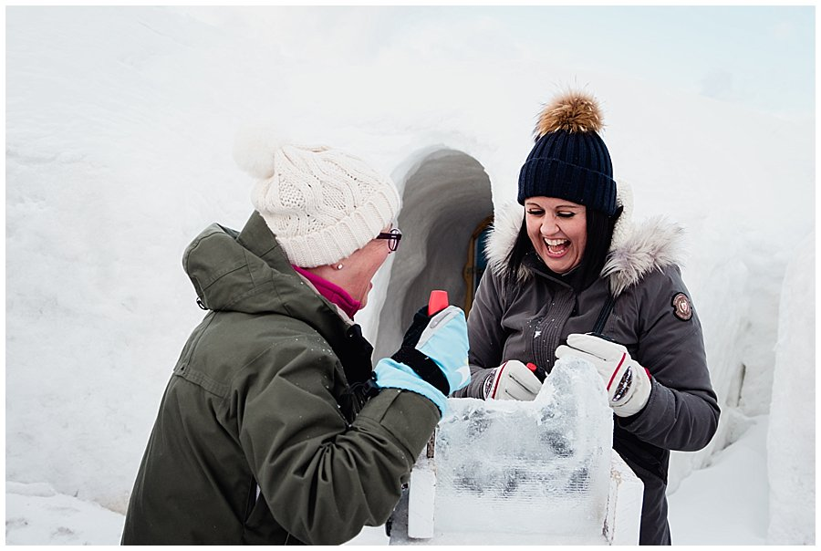 the girls laugh as their ice sculpture starts to take shape