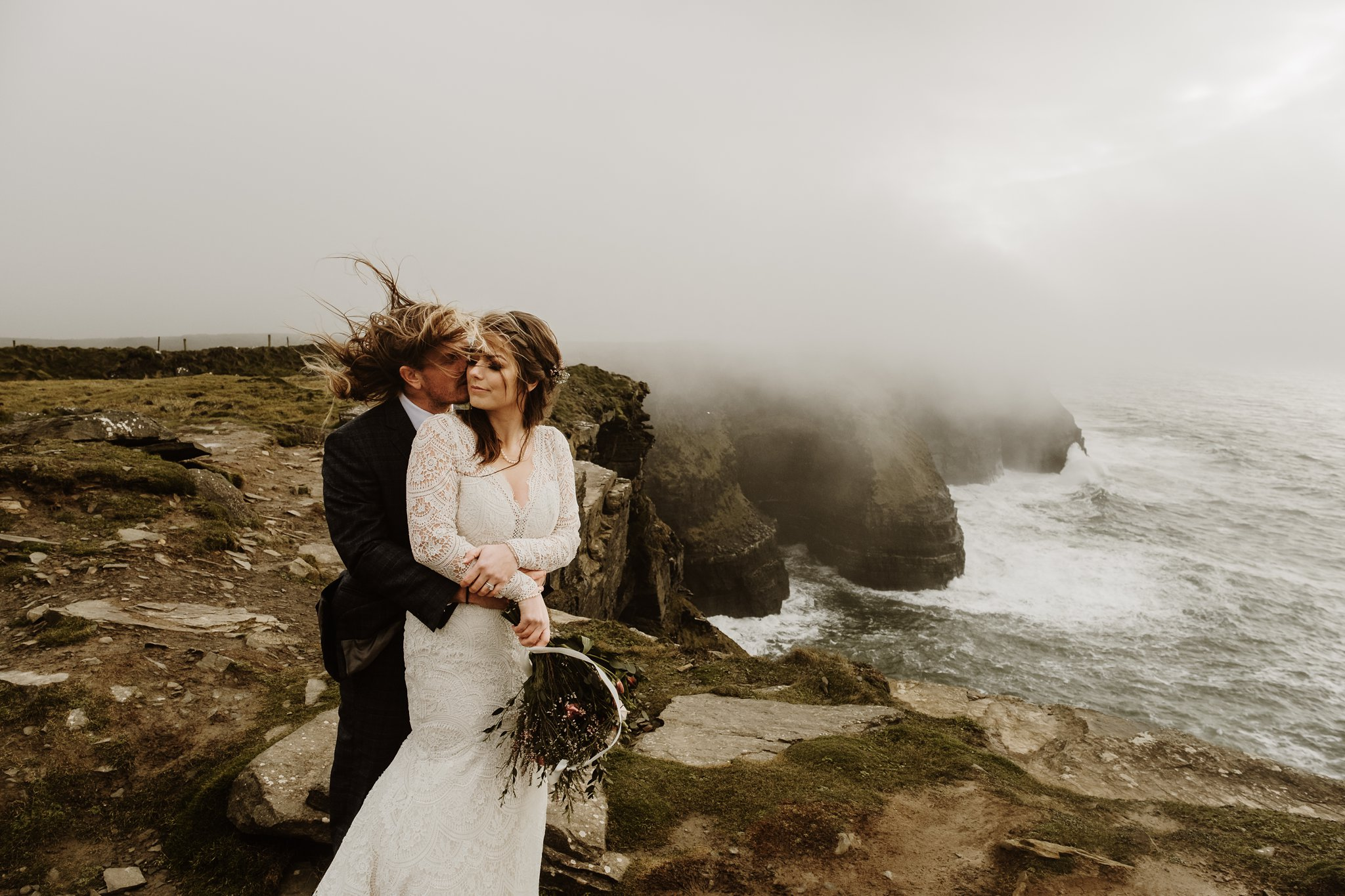A wild and romantic Cliffs of Moher elopement in Ireland. Photos by Europe Elopement Photographer Wild Connections Photography
