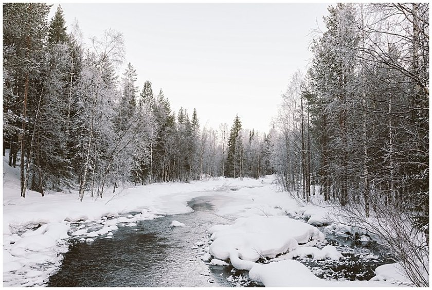 An almost Frozen River in Levi Finland by Wild Connections Photography