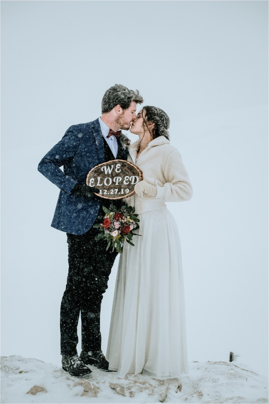 """Bride and groom holding a """"We Eloped"""" sign. Photos by Wild Connections Photography"""