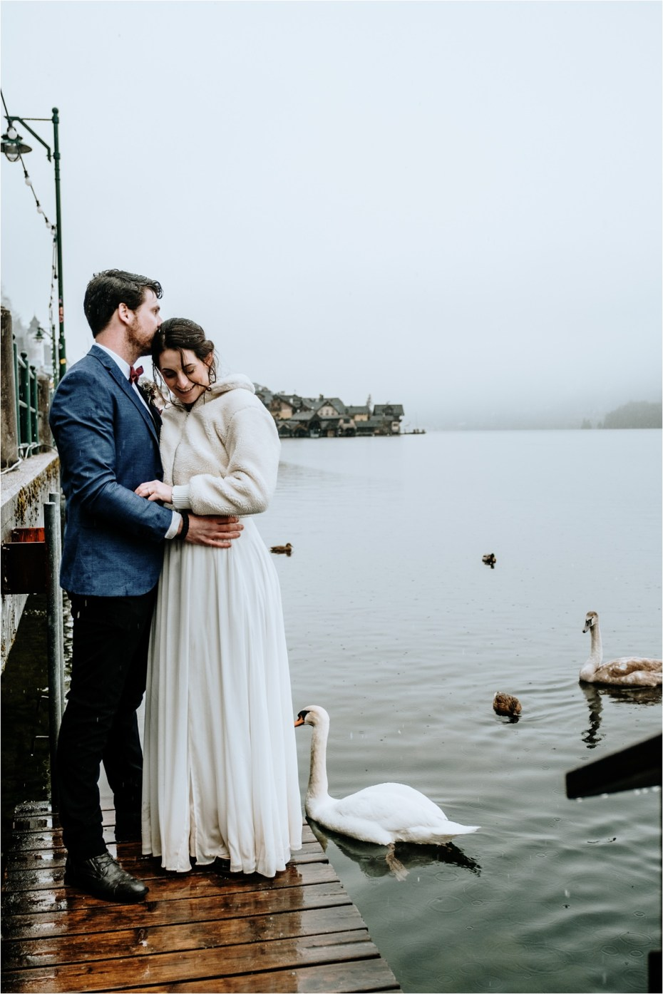 Swans swim up to the bride and groom after their Hallstatt wedding in Austria. Photos by Wild Connections Photography