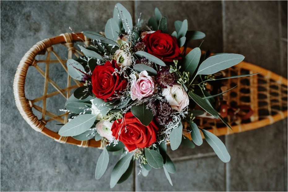 A winter bouquet on a vintage snowshoe. Photos by Wild Connections Photography