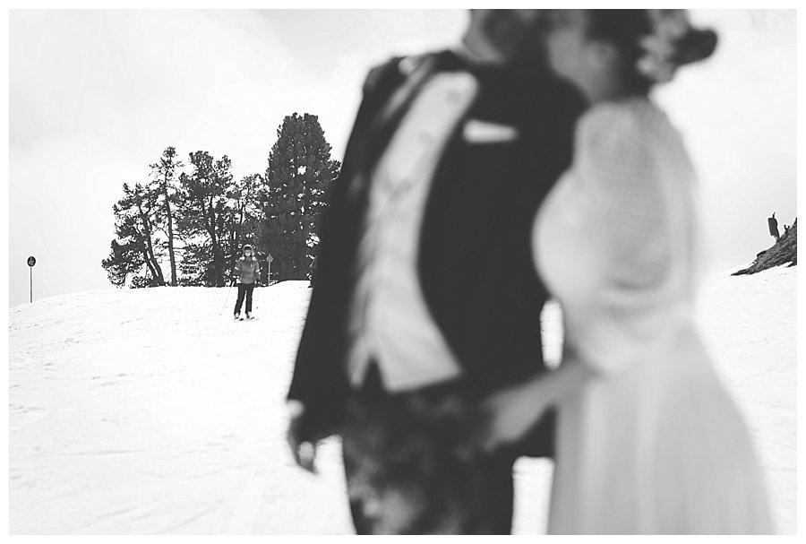 Susana and Tiago kissing as skiers ski around them
