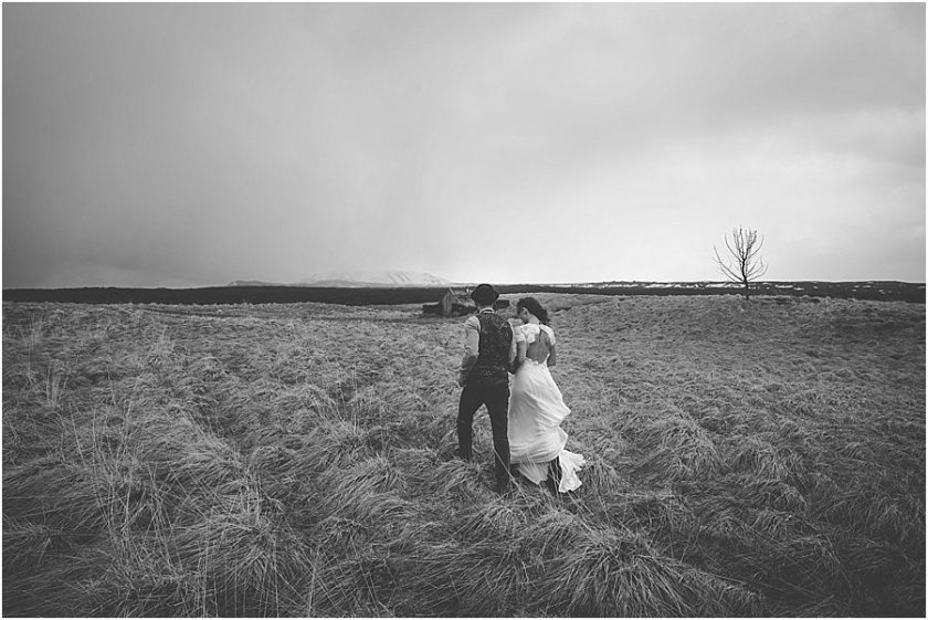 Thingvellir Iceland wedding photograph of couple walking in a field