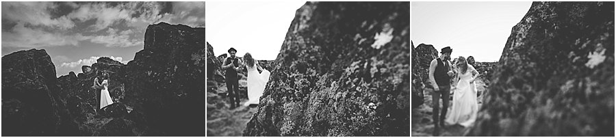 Bride and groom walking among the rocks