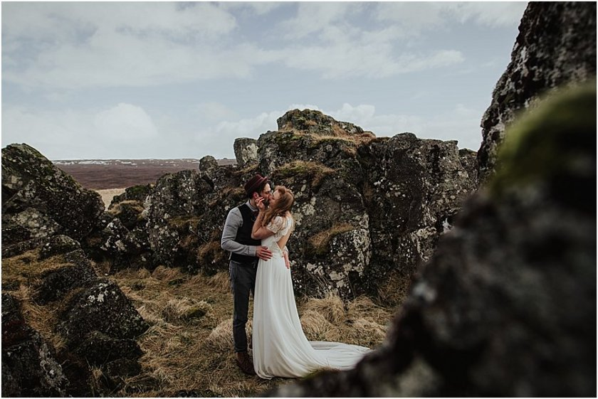 Bride and groom kissing in Thingvellir National Park