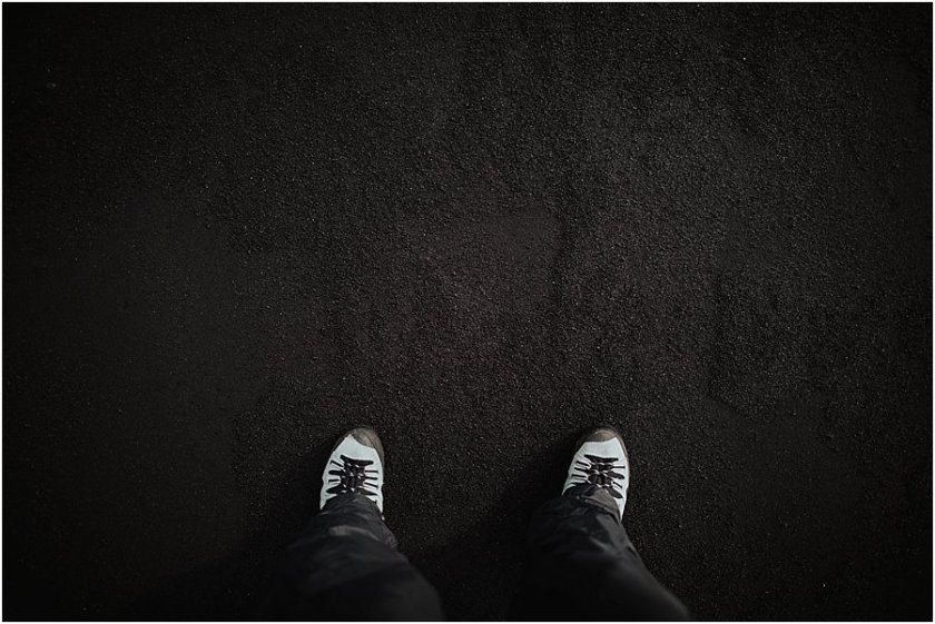 Shoe selfie standing on the black beach in Vik