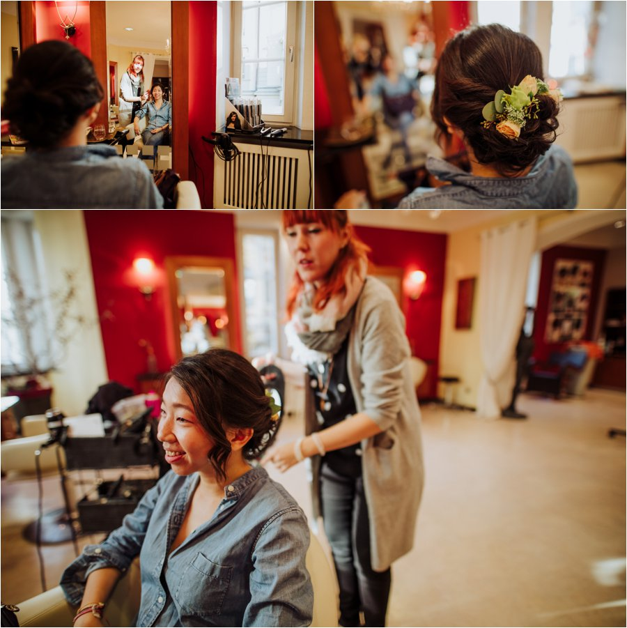 The bride Kelly has flowers in her loose elegant up-do for her Innsbruck wedding by Wild Connections Photography