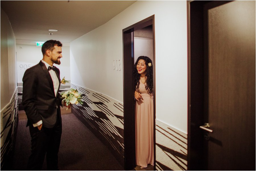 Arik arrives at Kelly's hotel room where her bridesmaid Cynthia opens the door by Wild Connections Photography