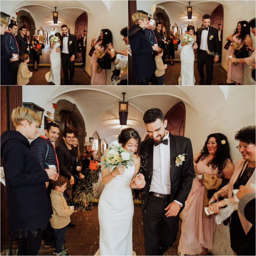 Kelly and Arik leave their Innsbruck wedding ceremony where they are showered in rice by their guests by Wild Connections Photography