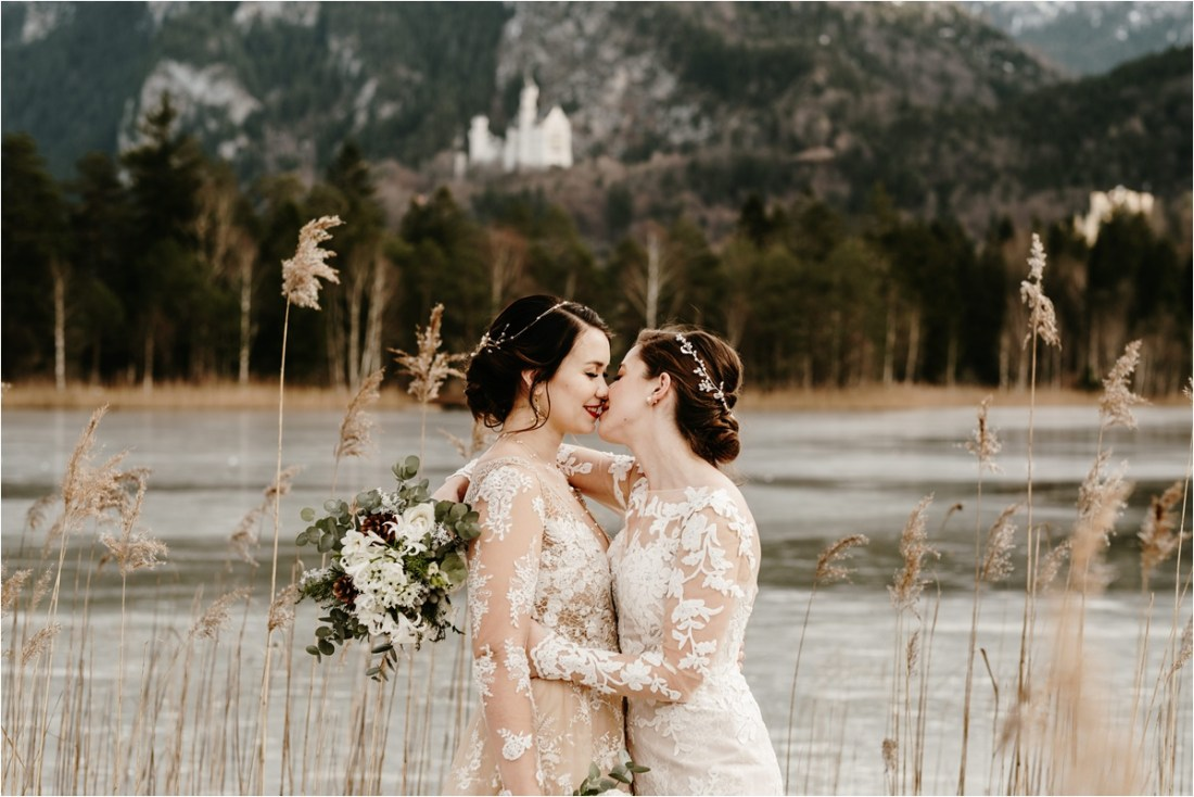 LGBT winter wedding at Neuschwanstein castle in Germany. Photo by Wild Connections Photography