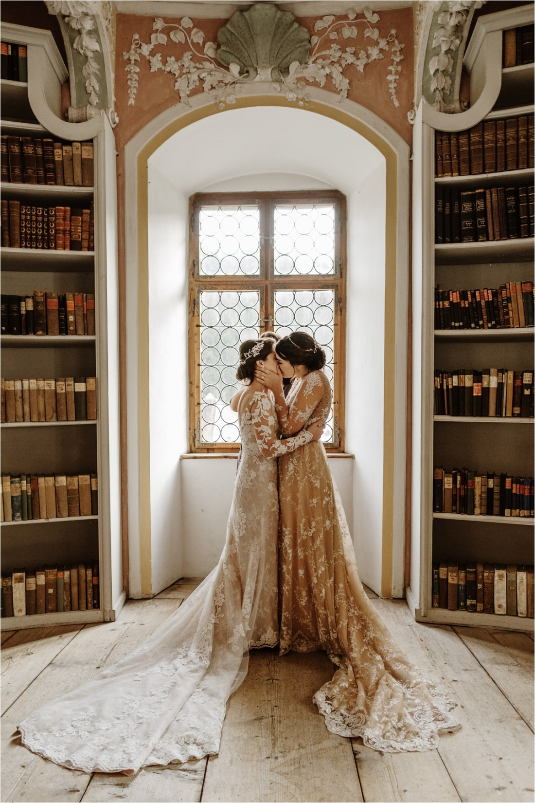 LGBT intimate wedding ceremony in a library in Germany. Photo by Wild Connections Photography