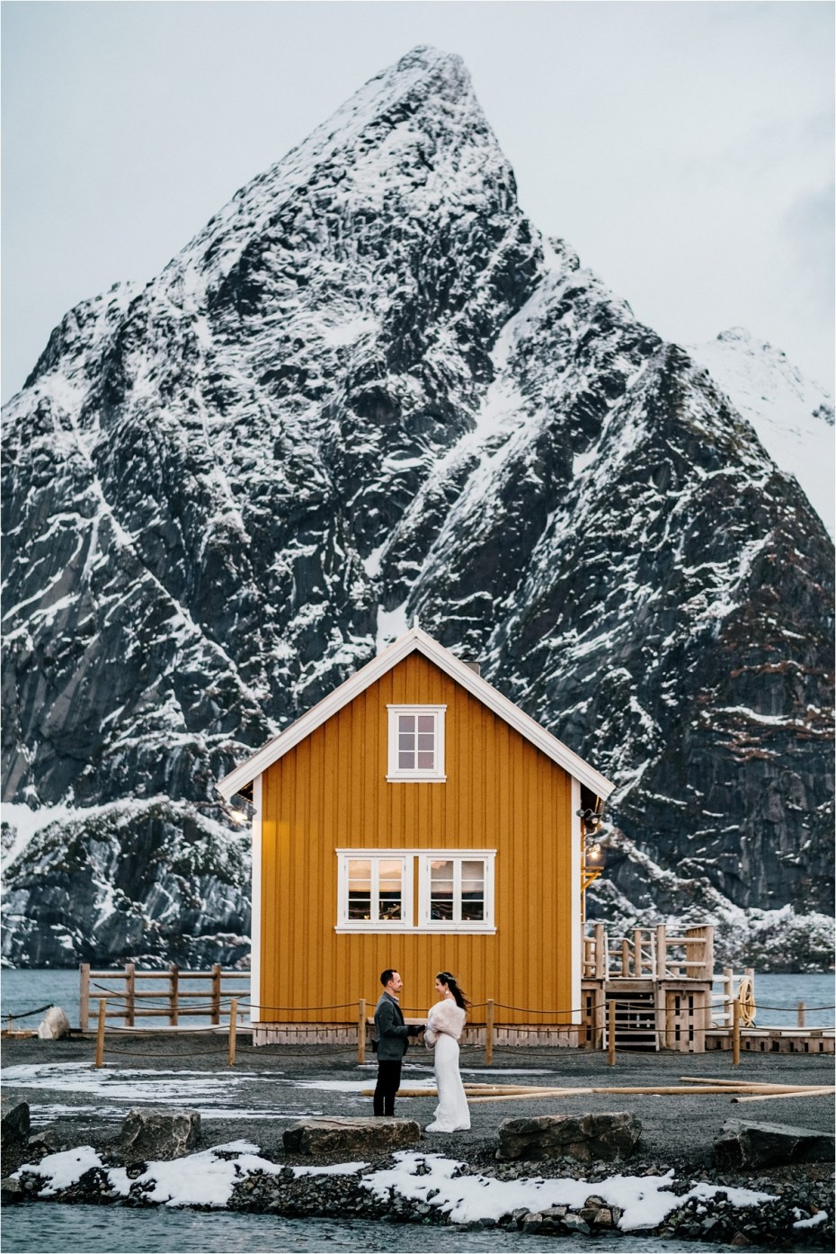 Norway winter elopement with fisherman's cabins. Photos by Wild Connections Photography