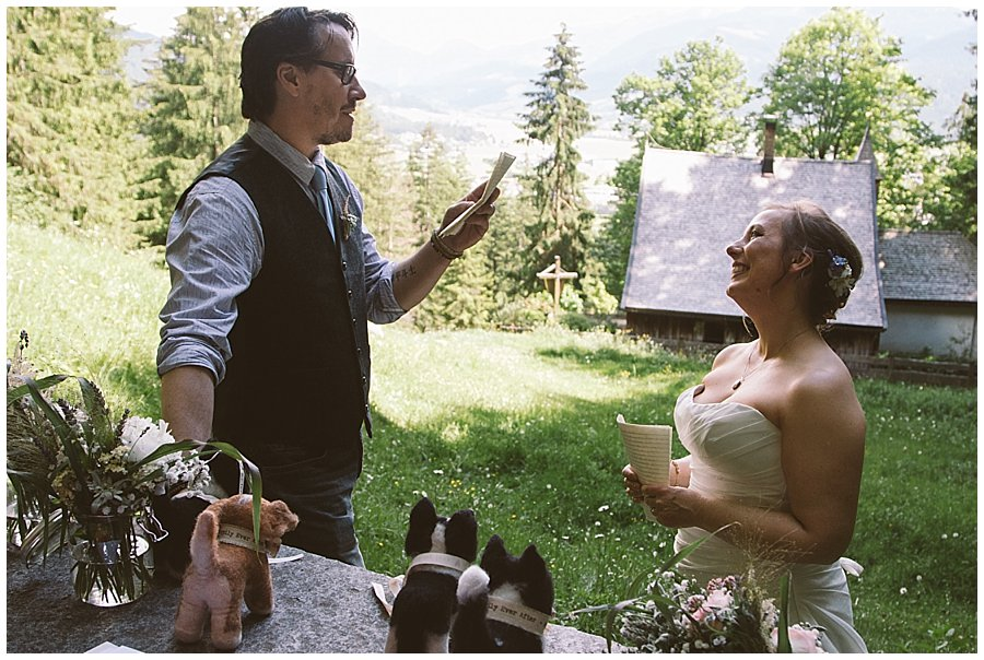 St Johann in Tirol Elopement Chris reads his vows to Nikki as she smiles at him adoringly by Wild Connections Photography