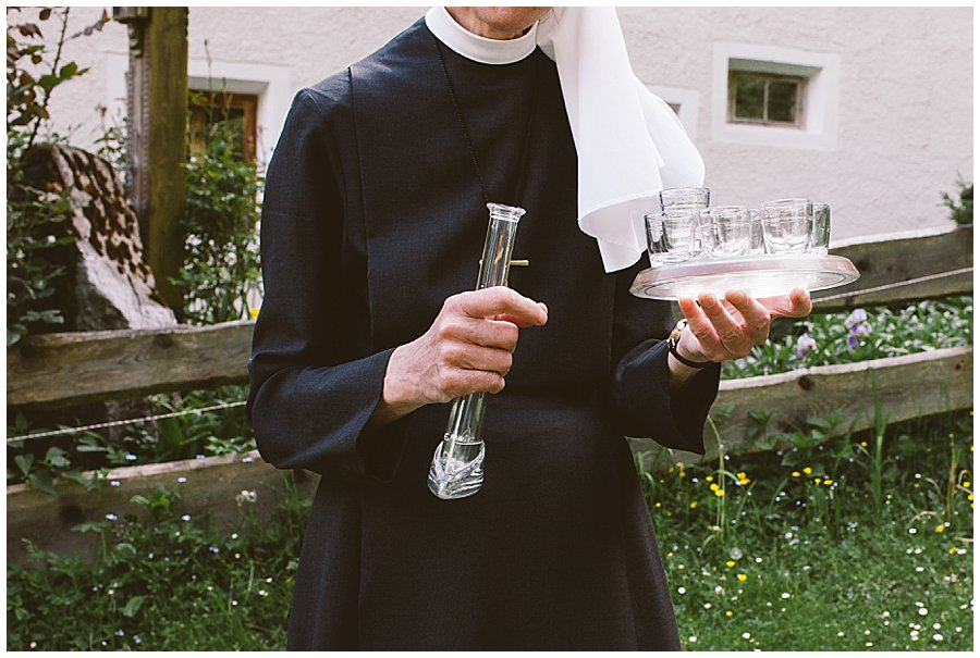 St Johann in Tirol Elopement homemade schnapps from the Nun living in the chapel by Wild Connections Photography