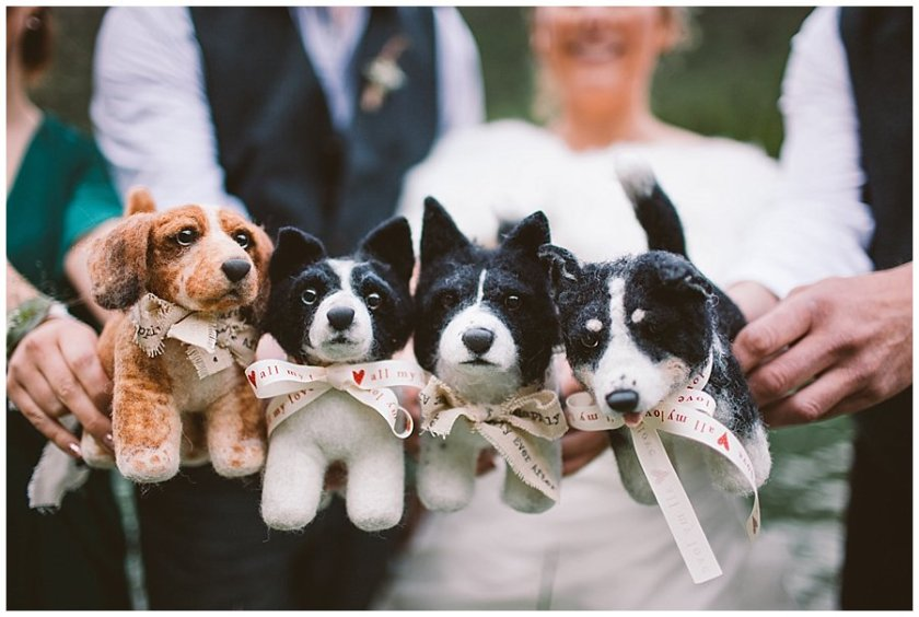 Mountain Wedding Shelter Pups made four replica dogs for the bride and groom which the wedding party are holding